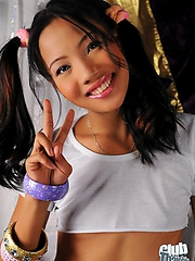 Jysa in pigtails showing small tits