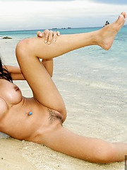 Thai babe Mintra nude on a beach