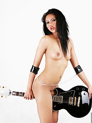 Thai unshaded Janice posing with her guitar
