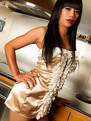 Thai Sherri in kitchen striptease