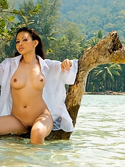 Thai babe Anya nude in wet skirt