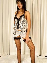 Sansanee in fishnet stockings