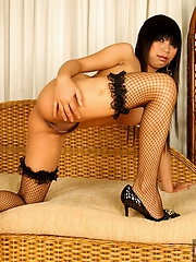 Thai Patti unadorned in fishnet stockings
