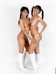 Teen Janice and Shanya posing in pigtails