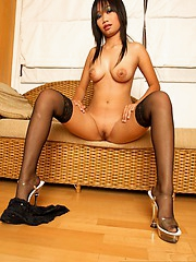 Thai Nicha nude in all directions black stockings