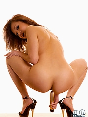 Shaved Jackie Lin with golden dildo