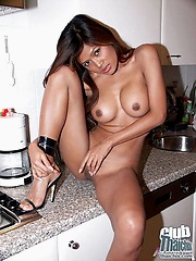 Busty Thai Acia nude in kitchen