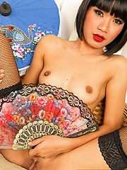 Sansanee spreading in fishnet stockings