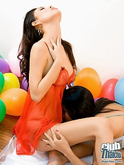 Thai Miko and Min playing with baloons