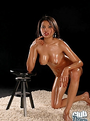 Shaved and busty Sai Tai oiled up