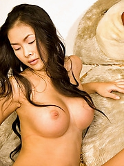 Busty Thai babe Emiko totally shorn