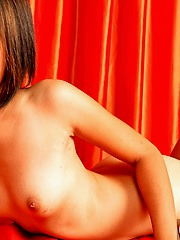 Shaved Thai Nan posing nude