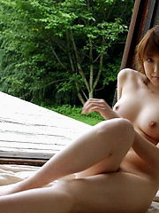 Horny Asian beauty enjoys posing nude and showing off her excellent body