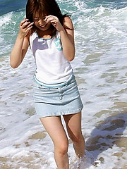 Asian beach bunny shows off her lovely body nude at the beach in the sun