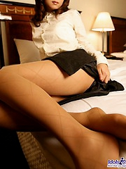 Naughty Misa in her lingerie masturbates over her white panties with her toy