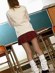 Schoolgirl shows off her big round tits and takes panties off showing anus