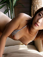 Sexy Japanese model shows her fine tits and tight ass in her lingerie