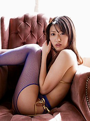 Japanese beauty is fingering her pussy through her crotchless fishnet stockings