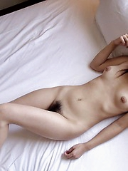 Naughty Asian slut Kana smiles as she shows off her tight ass and lovely titties