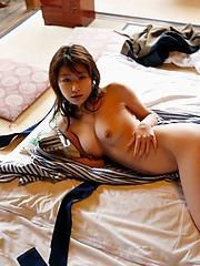 Lovely Asian babe takes off her lingerie and shows her lovely tits and pussy