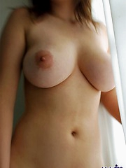 Asian beauty is a naughty slut who likes to show her ass and  firm round tits