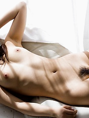 Beautiful Rina enjoys her beach hhouse and playing nude in the sun