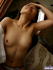 Japanese harlot loves pulling her shirt up to show off her firm tits and pussy