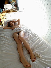 Lovely Asian model has a tight hairy pussy and a firm ass and tits to fuck
