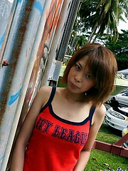 Slutty Asian teen poses in her red lingerie showing her great tits
