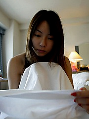 Hot Asian teen model shows off her hot body as she is dressing