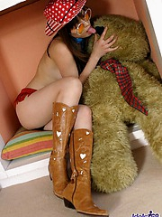 Hot Asian cowgirl  is very fuckable in her hat and boots and just waiting to go