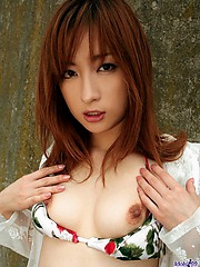 Asian babe slowly strips and reveals her nice tits and ass before dressing