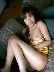 Hot Japanese hooker slowly shows off her tits and ass as she is posing for photo