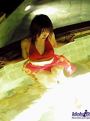 Naughty Hitomi enjoys flashing her hot body while she is wearing her sarong