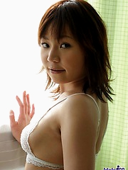 Japanese tramp smiles as she shows naked hairy pussy and her perfect tight ass