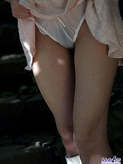 Naughty Nana shyly shows off her white panties as she lifts her mini skirt high