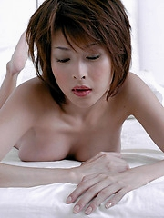 Asian slut is a cock tease and shows off her hot tits and a peek at her pussy