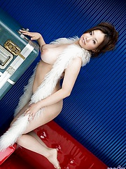 Gorgeous Asian doll models her hot lingerie and shows her excellent big tits