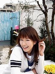 Towa Aino schoolgitl model shows off big boob cleavage in an open shirt