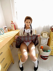 Asian schoolgirl is an adorable teen who loves showing off her hot body
