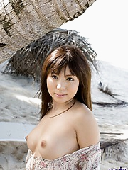 Aya is an Asian babe who shows her big tits and hairy pussy on the beach