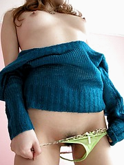 Naughty Japanese tramp slides panties off to show her hairy hot pussy in photos