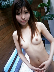 Naughty Asian slut shyly shows off her white panties as she lifts her mini skirt