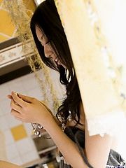 Cute Japanese sex doll lifts her dress and shows her tight hairy pussy