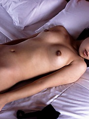 Cute Asian model is a cock tease who plays shy before showing off her sexy body