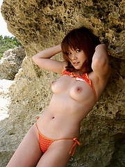 Asian tramp enjoys being naked at the beach showing hairy pussy off for pictures