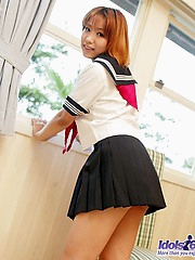 Yuri is an Asian slut who enjoys teasing the guys when she wears her sailor suit