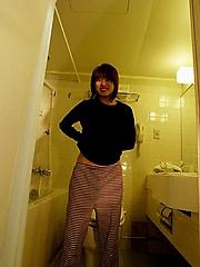 Hitomi Hayasaka Asian teen disrobing for a hot bath showing nude hot body