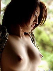 Japanese tramp with an open red kimono waiting for her next fucking appointment