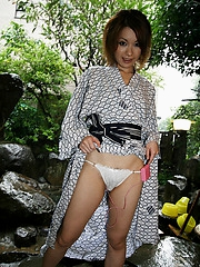 Asian slut in a kimono is masturbating and pinching her hard nipples in her bed